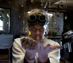 Dr. Horrible (Neil Patrick Harris) does some weird thing with his fingers to freak out his blog viewers.